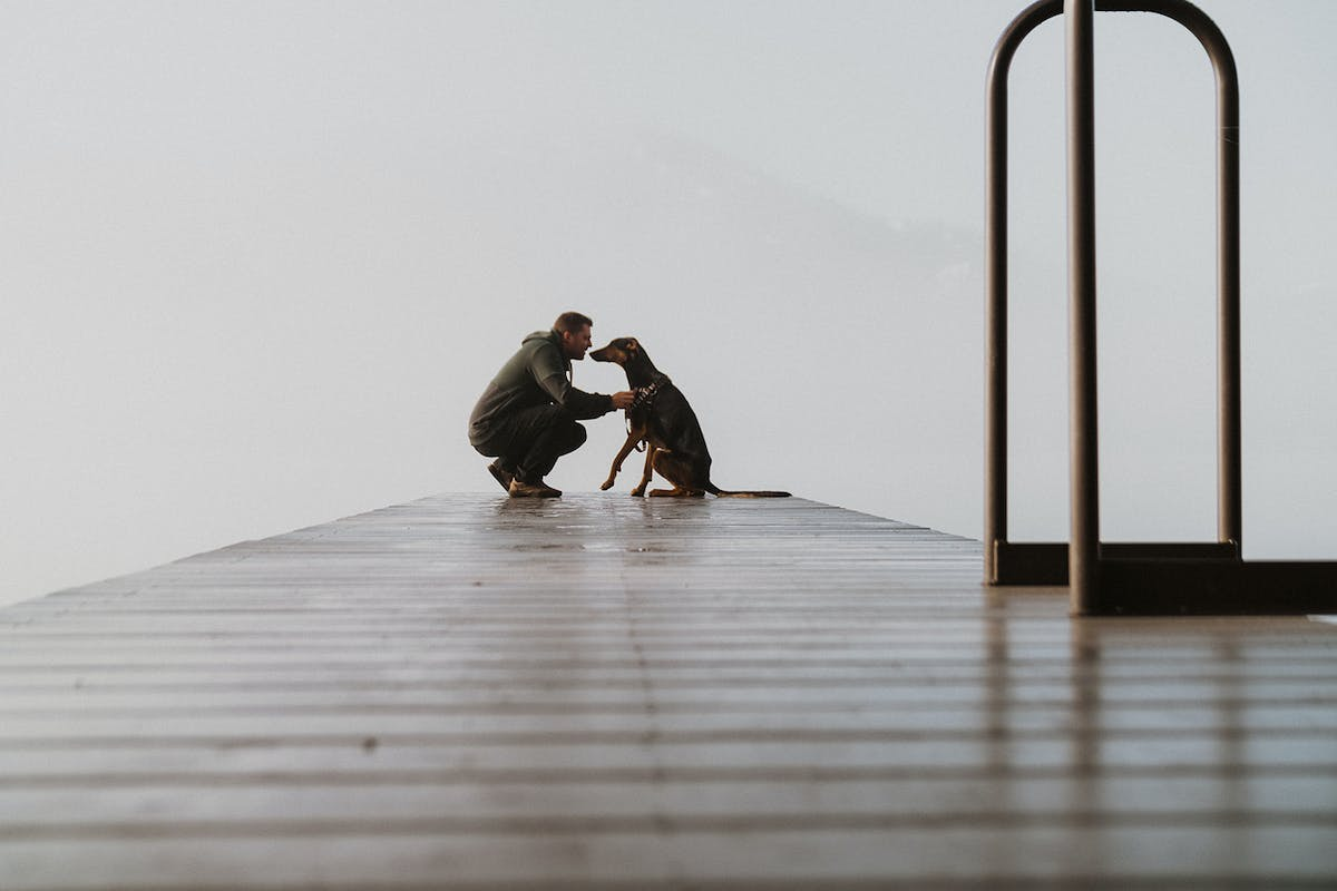 Ayla and Travis on a dock.