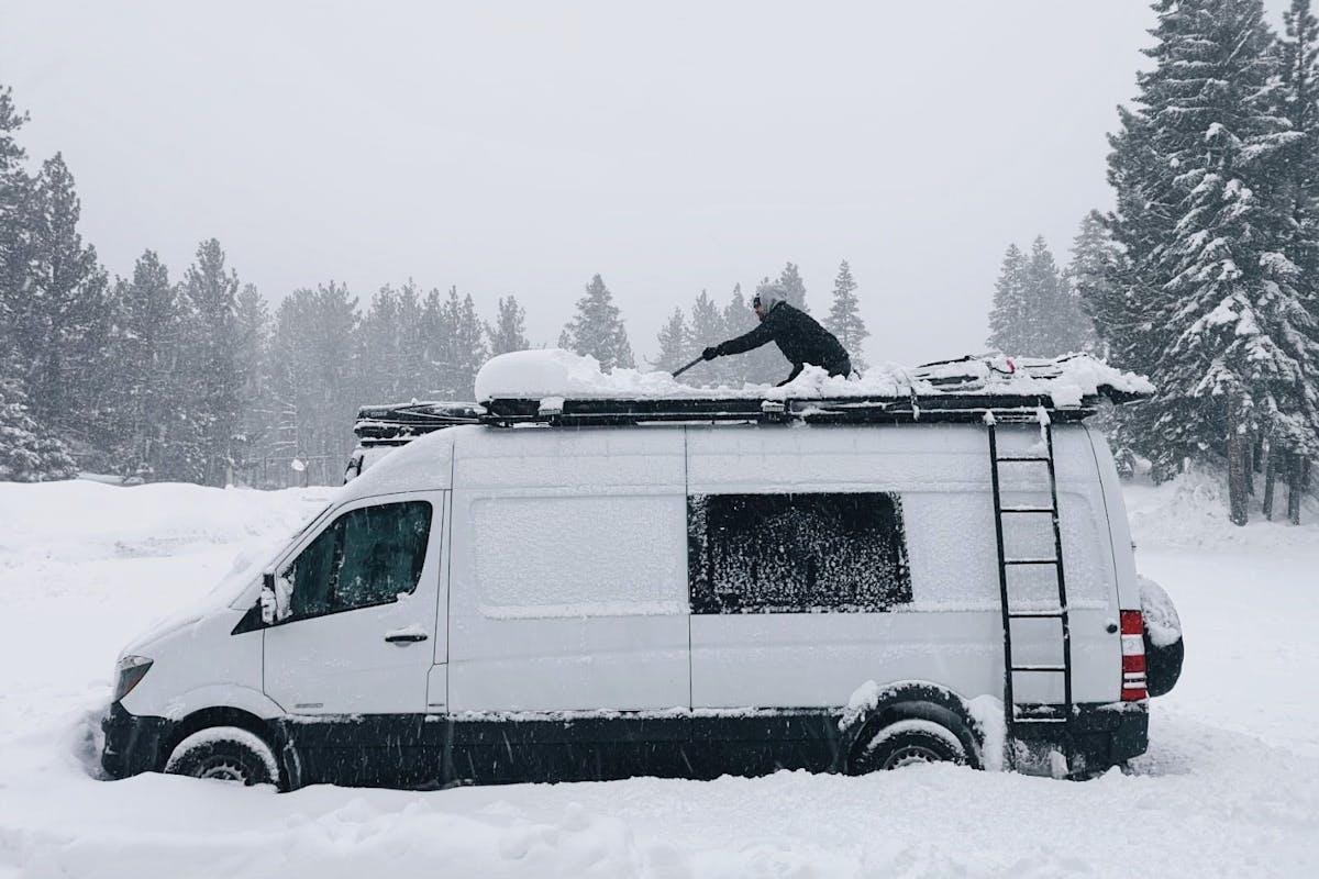 Scott shovelling the top of the van.